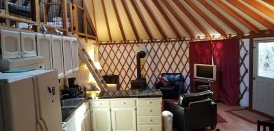 Interior of Yurt with kitchen and living room area